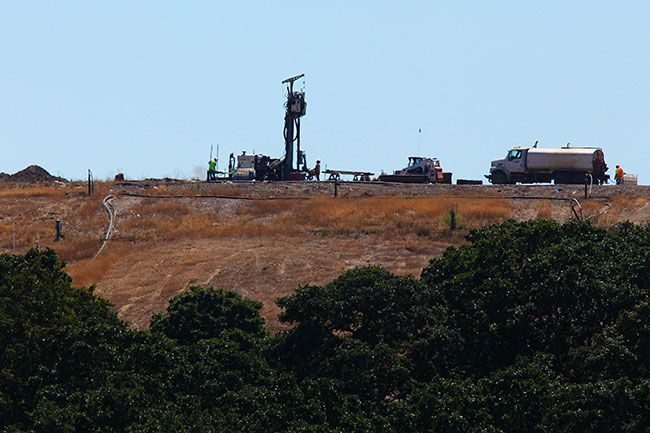 Rockne Roll/News-Register file photo##Riverbend Landfill employees and contractors operate a drill rig. According to spokeswoman Jackie Lang, a similar machine will be used in coming months when Riverbend installs more gas collection wells.