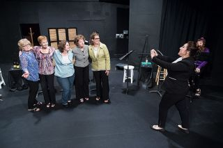 "Marcus Larson/News-Register##In ""A Week of Augusts,"" Jay (Leticia Duran) photographs friends, from left, Dot (Joanne Walker), Evie (Tami Dingle Keller), Gail (Shannon Braume), Marge (Meredith Symons) and Joyce (Paige Lomas)."