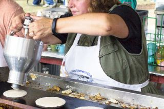 News-Register photo archive##Carol Riley pours batter onto the stove at the Amity Pancake Breakfast and Car Show in July. The event may cease to exist in the future because of dwindling involvement in the Amity Valley Women's Club.