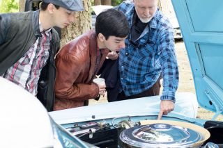 Michaela Fujita-Conrads/News-Register##Bill Fisher, Nolan Inouye and Owen Inouye examine the engine of an antique car at the Amity Pancake Breakfast and Car Show on July 26.