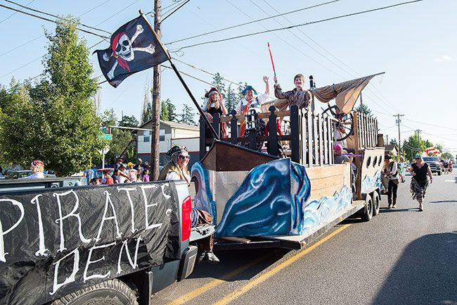 Marcus Larson/News-Register##The Pirates Den float goes by during the Dayton Old-Timers Festival. The three day event dates back to humble beginnings in 1934 with a potluck picnic.
