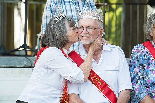 Marcus Larson/News-Register##Moments after being crowned king and queen of the Dayton Old-Timers festival, Catherine Poe gives John Francis a kiss to celebrate their coronation.