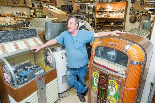 Marcus Larson/News-Register##Restoration expert Tony Cerasin keeps himself busy restoring vintage radios and jukeboxes out of a Newberg garage packed with machines, tools and parts.