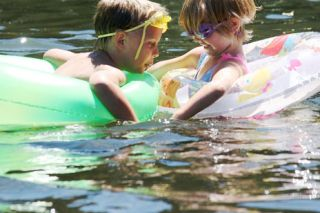 Rockne Roll / News-Register##Children try to beat the heat on a hot July day.