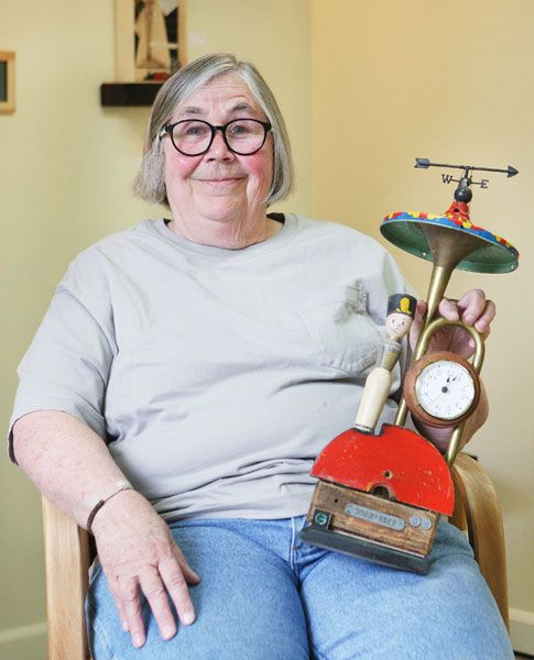 Rockne Roll / News-Register##Ann Durley uses found objects to create her clocks and furniture pieces, including dominoes and croquet mallets she used to decorate a chair.