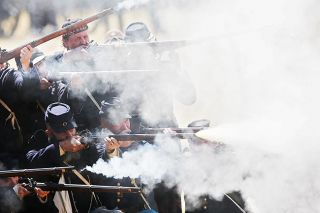 Stephen Young photo##A group of Union re-enactors opens fire at Willamette Mission State Park. The Union Army consisted of the small (at the time) U.S. Army, known as the regular army — bolstered by massive numbers of units