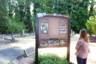 Starla Pointer / News-Register##Molly Casperson of the BLM takes a look at the Brookside Cemetery s new sign.