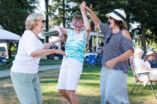 Marcus Larson / News-Register##Friends Judy Rondolph, Pam Fuller and Cat Bowdish dance to live music at the Dayton Old Timers Festival.