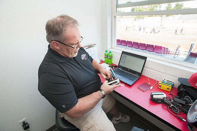 Marcus Larson/News-RegisterJoe Miglioretto works from the press box during Salem-Keizer Volcanoes games, charting pitches and processing video.