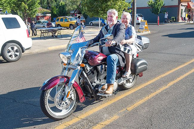 Marcus Larson/News-Register##Queen Mary Baker and King James Connelly ride a motorcycle in the Dayton Old Timers parade. Riding a motorcycle has always been on Mary Baker s bucket list.