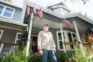 "Marcus Larson/News-Register##Al Arguedas, in front of his McMinnville home, has lived in the United States since 1964 and McMinnville since 1979. ""I love this country,"" he says. ""It's an honor to be here."""