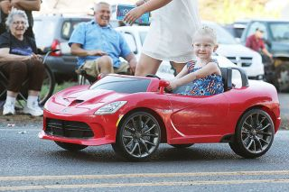 Rockne Roll/News-Register##A young parade participant pilots her Dodge Viper-styled riding toy on Third Street in Dayton during last year's Dayton Old Timers Weekend parade.