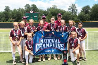 Submitted photo##The Corvallis Lady Knights celebrate their championship in Arizona two weeks ago. Local members of the team in the top row are Charlotte Terry (second from left), Maddix Bowdle (fourth from left) and Mackenzie Bekofsky (fifth from left).