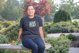 Rockne Roll / News-Register##Alejandra Cortes sits outside St. James Catholic Church, where her event to raise awareness of organ donation is held.
