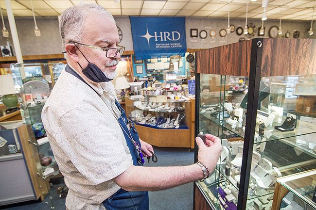Marcus Larson/News-Register ## David Spalding examines a rare pink diamond for sale in his store, Timmreck & McNicol Jewelers in McMinnville. He finds unusual and beautiful stones on his semi-annual buying trips to world diamond markets.