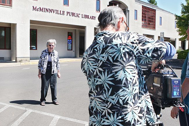 Rockne Roll / News-Register##Rose Marie Caughran introduces herself as Oregon Art Beat videographer Tom Shrider captures the shot,