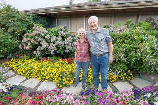 Marcus Larson/News-RegisterBob and Darlene Bogetti revel in their ability to surround themselves with flowers. Their efforts have earned them Yard of the Month honors — again.
