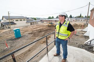 Marcus Larson/News-Register##Superintendent Charan Cline describes the extensive construction at Yamhill-Carlton High School. An 800-seat gym and a  career-tech center, both round, domed buildings, are among additions.