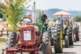 Marcus Larson/News-Register##Kade Weeks waits his turn in the tractor parade during the Harvest Fest event on Saturday.