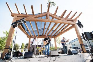 News-Register file photo##The band Ships to Roam plays in the Granary District during last year's Walnut City Music Festival. This year's event runs Friday and Saturday, Aug. 19-20.