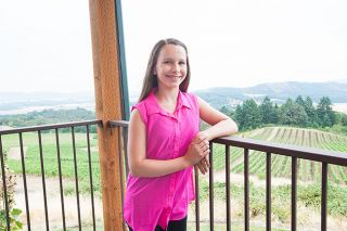 Marcus Larson/News-RegisterEleven-year-old Jordan Bailey will sing with the Salem Concert Band on Sunday during a movie-themed concert at her parents' winery, Youngberg Hill Vineyards.