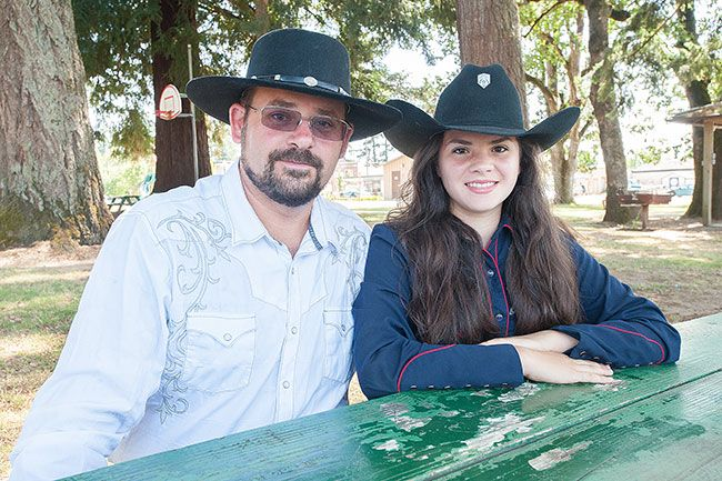 Marcus Larson/News-RegisterScott Bateman and daughter Julianna are fast-draw competitors. They're hosting a world championship event this weekend.