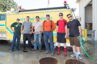 Marcus Larson / News-Register##From left, Jeremy Plummer, Jeff Nichols, Cody Coonrod, Blake Paulson, Justin Bobbett and Tanner Morton were part of a local task force of firefighters who returned Tuesday from combating the Cornet-Windy Ridge Complex fire in Eastern Oregon.