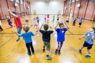 Marcus Larson/News-Register##Kindergartners  shake it all about  as they learn to do the Hokey Pokey during this week s back-to-school camp at Memorial Elementary.