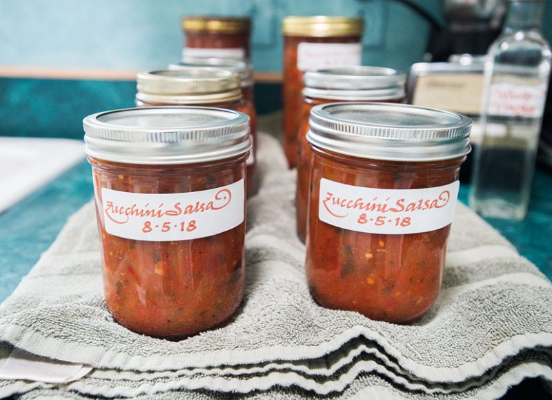 Marcus Larson/News-Register##Jars of home-canned salsa are embellished with calligraphed labels.