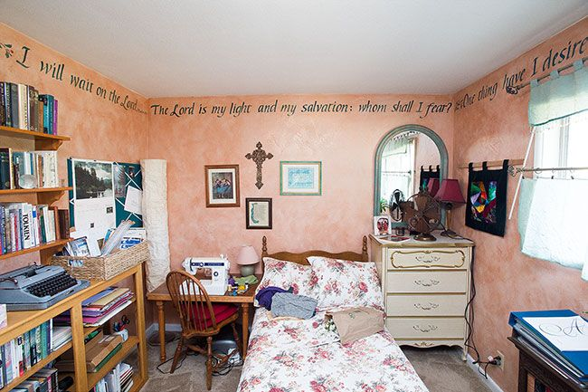 Marcus Larson/News-Register##Susan Newby converted her daughter's former bedroom into a sewing room, encircling the space with her calligraphy.