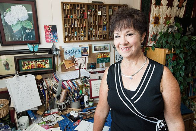 "Marcus Larson/News-Register##Susan Newby, pictured in the workroom of her McMinnville home, has been practicing calligraphy since high school. ""Everybody should find a way to be creative,"" she said."