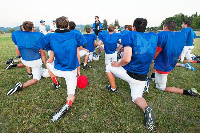 Marcus Larson/News-RegisterAmity head football coach Justin Amaya speaks to his team during practice Friday.