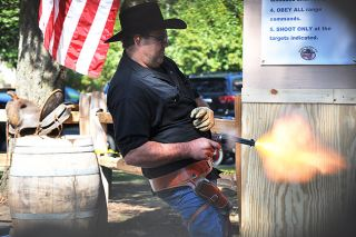 Robert Husseman/News-RegisterShawn Anderson of Sweet Home fires his weapon during competition Sunday.