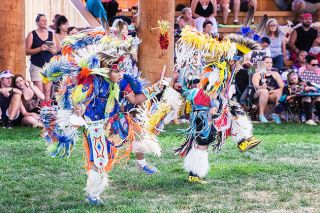 Marcus Larson/News-Register##Apollo Johnson and Sun Hawk Barney compete in the Junior Boys Fancy division Saturday during the Confederated Tribes of Grand Ronde Contest Powwow at the Uyxat Powwow Grounds.