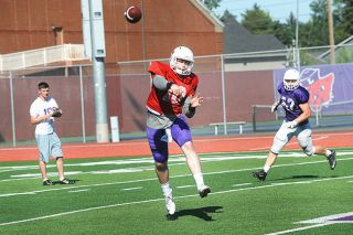 Rusty Rae/News-Register## Linfield QB Same Riddle in scrimmage at Maxwell Field.