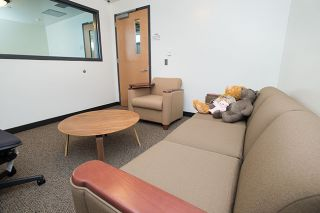 Marcus Larson / News-Register##A comfortable couch and stuffed animals help make up the soft interview room at the McMinnville Police Department. The space was created to calm the nerves of sexual assault victims while they talk to detectives.