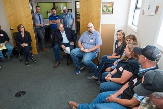 Marcus Larson/News-Register##Gov. Kate Brown, left, and Sen. Jeff Merkley discuss issues with area farmers during a visit to Organic Valley Creamery in McMinnville.