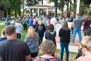 Marcus Larson / News-Register##Dayton residents join members of the Cordie family at a vigil for Meigham Cordie in Courthouse Square Park Friday.