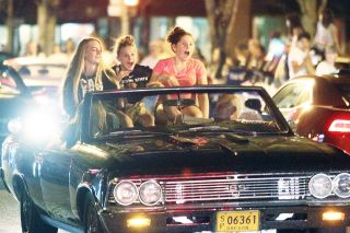 Rockne Roll/News-Register##Passengers in a Chevrolet Chevelle SS cruise down Third Street during Dragging the Gut on Friday, Aug. 26, in McMinnville.