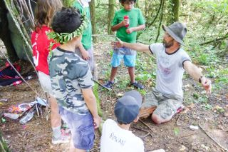 Starla Pointer / News-Register##Joey Vogt tells youngsters about survival techniques at the McMinnville disaster camp.