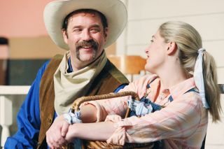 "Rockne Roll / News-Register##Curly (Lance Nuttman) and Laurey (Karen Kumley) share a flirtatious moment in ""Oklahoma!"""