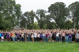 Marcus Larson / News-Register##New Linfield students pose for a class photo near the campus Oak Grove, all