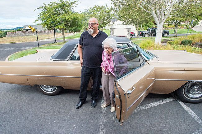 Marcus Larson / News-Register##Ellie Tibbetts celebrates her special birthday in style with a ride in a golden Caddie.