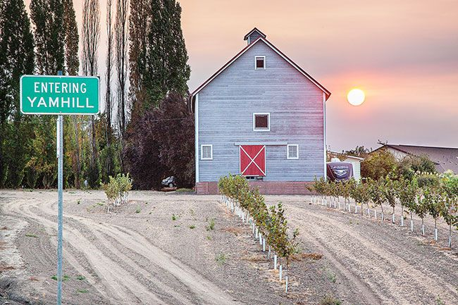 Rockne Roll/News-Register##The sun sets over a barn on the north side of Yamhill Sunday. Smoky skies from regional wildfires have produced picturesque sunsets and sunrises, but have created numerous health hazards in the Valley.