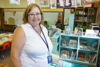 Starla Pointer/News-Register##Dayna Gilbert, a familiar face as a sub in the McMinnville School District, now has her own classroom at Memorial School. She welcomed kindergartners today.