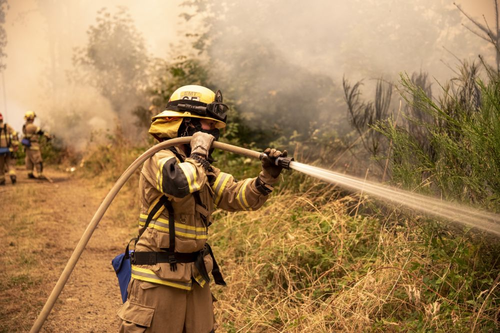 Tualatin Valley Fire & Rescue photo##Crews work to hold back the wildfire in the Chehalem Mountains north of Newberg.