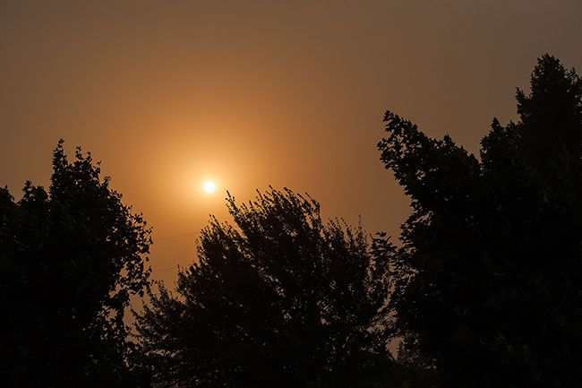 Rusty Rae / News-Register##Smoke turns the sky yellow over Yamhill County and causes poor air quality, leading schools, recreation facilities and some businesses to close.