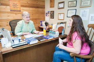 News-Register file photo##Provoking Hope founder Diane Reynolds works with a patient.