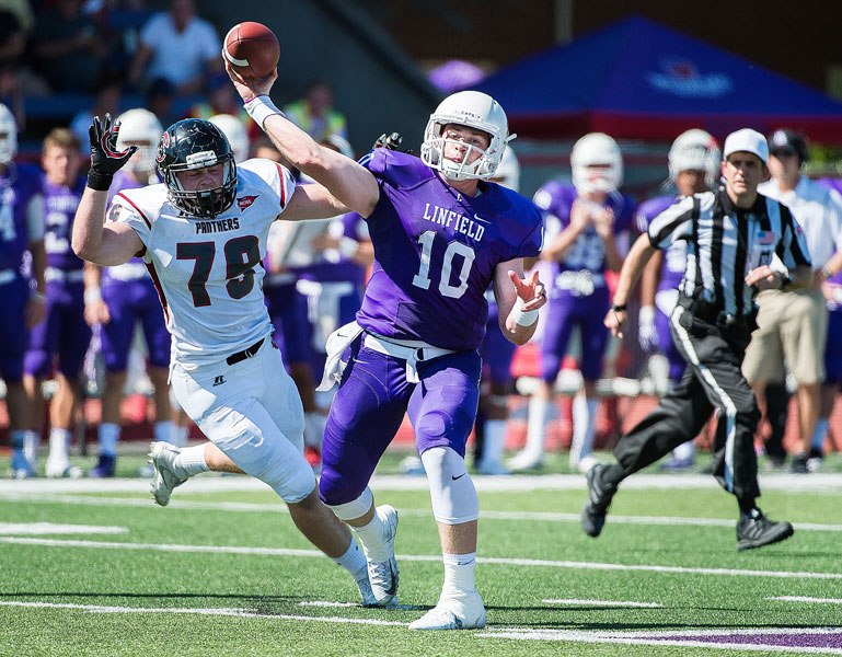 Marcus Larson/News-Register## Linfield senior All-NWC QB Sam Riddle gets off one of 38 passes he threw in the Wildcats  victory over Chapman.