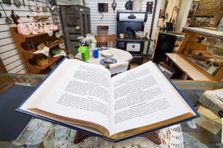 Marcus Larson/News-Register##The museum includes a kitchen area with an array of vintage cookbooks.